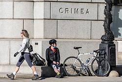 © Licensed to London News Pictures. 25/03/2020. London, UK. A walker and cyclist exercise in Pall Mall during lockdown as Prime Minister Boris Johnson orders police to enforced the new rules. Prince Charles is confirmed to have contracted Covid19 as the crisis continues. Photo credit: Alex Lentati/LNP