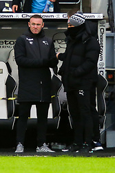 Derby County manager Wayne Rooney talks with Rotherham United manager Paul Warne - Mandatory by-line: Ryan Crockett/JMP - 16/01/2021 - FOOTBALL - Pride Park Stadium - Derby, England - Derby County v Rotherham United - Sky Bet Championship