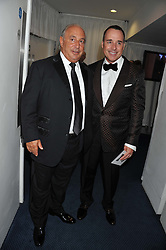 Left to right, SIR PHILIP GREEN and DAVID FURNISH at the GQ Men of The Year Awards 2012 held at The Royal Opera House, London on 4th September 2012.