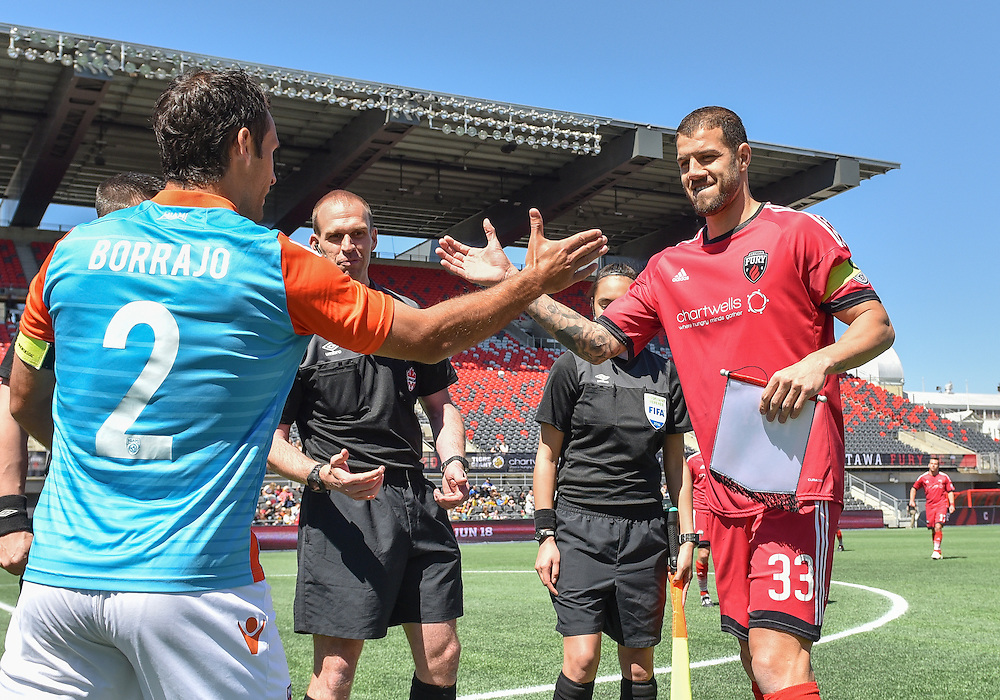 Ottawa Fury FC defender Rafael Alves (#33) and Miami FC defender Jonathan Borrajo (#2) shake hands before the NASL match between the Ottawa Fury FC and Miami FC at TD Place Stadium in Ottawa, ON. Canada on April 30, 2016. The Fury claiming their first win of the season with a 2-0 victory thanks to goals from Fernando Timbo and Dennis Chin.<br /> <br /> PHOTO: Steve Kingsman/Freestyle Photography