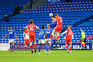 Cardiff City's Kieffer Moore (10) competes for a high ball with Millwall's Shaun Hutchinson (4) during the EFL Sky Bet Championship match between Cardiff City and Millwall at the Cardiff City Stadium, Cardiff, Wales on 30 January 2021.
