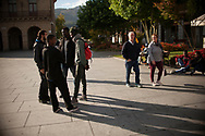 Some African migrants spend the day in the main square.  Irun (Basque Country). October 15, 2018. A group of volunteers has created a host network to serve migrants and inform about the public services they are entitled to and the ways to cross the border. This group of volunteers is avoiding a serious humanitarian problem Irun, the Basque municipality on the border with Hendaye. As the number of migrants arriving on the coasts of southern Spain incresead, more and more migrants are heading north to the border city of Irun. French authorities have reacted by conducting random checks as far as the city of Bordeaux, more than 200 kilometers north of the border. Migrants who are caught are then deported back to Irun. (Gari Garaialde / Bostok Photo).