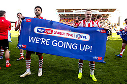 Bruno Andrade and Danny Rowe of Lincoln City celebrate winning promotion from Sky Bet League Two to Sky Bet League One - Mandatory by-line: Robbie Stephenson/JMP - 13/04/2019 - FOOTBALL - Sincil Bank Stadium - Lincoln, England - Lincoln City v Cheltenham Town - Sky Bet League Two