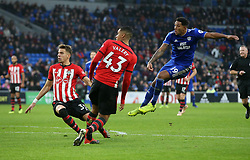 Cardiff City's Nathaniel Mendez-Laing takes a shot during the Premier League match at the Cardiff City Stadium, Cardiff.
