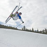 SKIING, Big Sky, Montana. Ben Wiltsie (MR) skis aerial manouvers in half pipe in terrain park at Big Sky Ski Resort, near Bozeman, Montana.