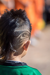 United States, Washington, Seattle.  A boy with the Seattle Seahawks football team logo shaved into his hair.