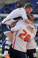 Bolton Wanderer's captain Jay Spearing jumps on goalscorer Joe Mason as he celebrates scoring his sides second goal. Skybet championship match, Bolton Wanderers v Blackburn Rovers at the Reebok Stadium in Bolton, England on Saturday 1st March 2014.<br /> pic by David Richards, Andrew Orchard sports photography.