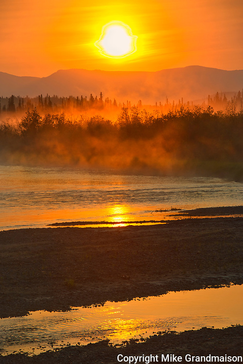 Rising fog on the Deasadeash River at sunrise and the Kluane Ranges, the easternmost of the St Elias Mountains. <br />Kluane National Park<br />Yukon<br />Canada