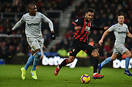 West Ham United Defender, Angelo Ogbonna (21) and AFC Bournemouth Forward, Josh King (17) challenge for the ball during the Premier League match between Bournemouth and West Ham United at the Vitality Stadium, Bournemouth, England on 19 January 2019.
