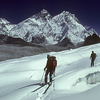 Skiers Jay Jensen and Dr. Peter Hackett skiing Changri Glacier, with Mounts Changtse, Everest, Lhotse, & Makalu, in background.