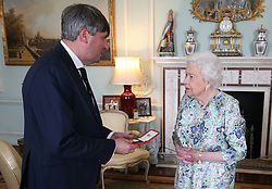 Queen Elizabeth II presents Simon Armitage with The Queen's Gold Medal for Poetry upon his appointment as Poet Laureate during an audience at Buckingham Palace, London.