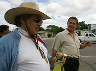 Jay Johnson Castro is joined by Hector Gonzalez of Paleteria La Chueca during his walk through Laredo on Tuesday, October 10, 2006. Castro said he was walking over 200 miles from Laredo to Brownsville to protest the proposed border wall along the Rio Grande.