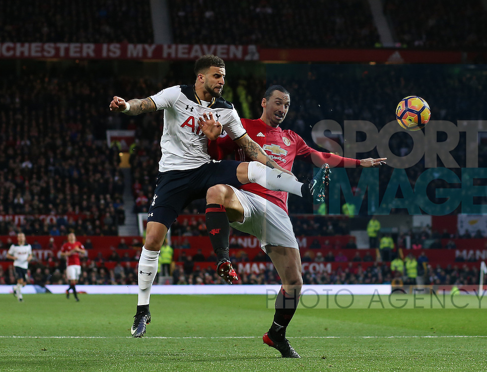 Kyle Walker of Tottenham challenges Zlatan Ibrahimovic of Manchester United during the English Premier League match at Old Trafford Stadium, Manchester. Picture date: December 11th, 2016. Pic Simon Bellis/Sportimage