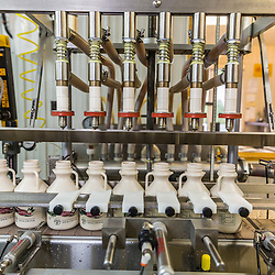 The bottling conveyer at Maine Maple Products in Madison, Maine. The majority of the syrup bottled here is harvested in Big Six Township, Maine.