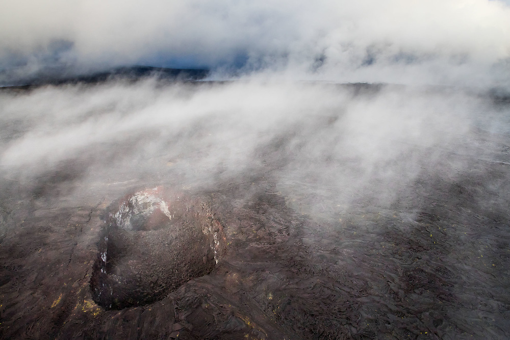 STEAM RISING OVER A CRATER ON THE KUPAIANAHA LAVA SHIELD (AERIAL VIEW), HAWAII VOLCANOES NATIONAL PARK, HAWAII