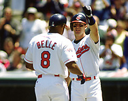 CLEVELAND - 1994:  Jim Thome greets Albert Belle of the Cleveland Indians during an MLB game at Jacobs Field in Cleveland, Ohio during the 1994 season. (Photo by Ron Vesely) Subject:   Jim Thome; Albert Belle