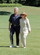 President Bill Clinton and first lady Hillary Clinton return from a short vacation to the Hamptons aboard Marine One on the South Lawn of the White House August 2, 1998 in Washington, DC. The Clintons left town as intern Monica Lewinsky made a deal for immunity in return for her cooperation in the investigation against President Clinton.