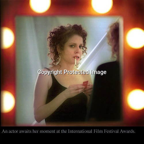An actor awaits her moment backstage at the International Film Festival Awards.