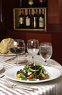 KEVIN BARTRAM/The Daily News.Composed salas of mesclun greens, goat cheese, toasted pine nuts, red and yellow tomatoes dressed in fine herbs and lemon vingarette prepared by San Luis Resort executive chef Sean Moore will be featured at the Junior League Pennies from Heaven evening.
