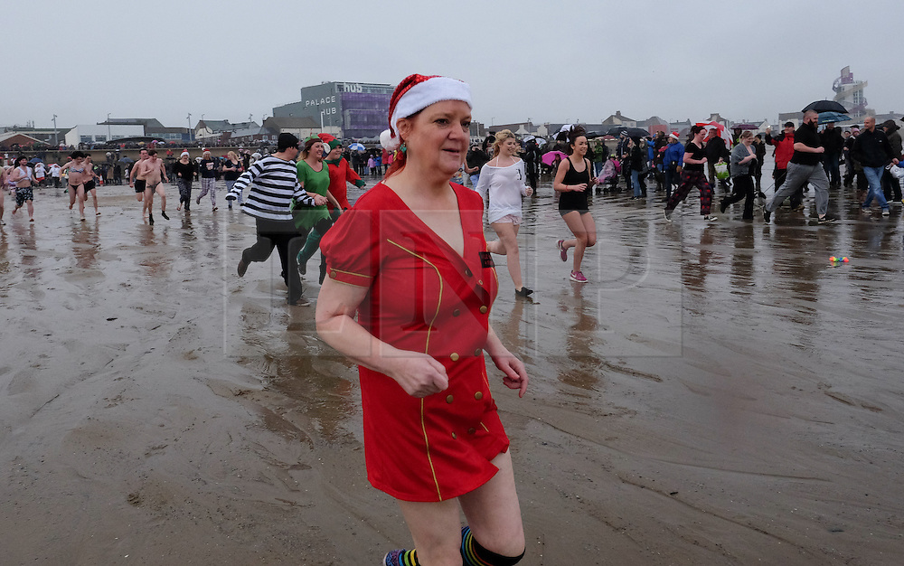 © Licensed to London News Pictures. 26/12/15<br /> Redcar, UK. <br /> <br /> Hundreds of people charge into the cold waters of the North sea as they take part in the annual Boxing Day dip at Redcar beach.<br /> <br /> The event which attracts many hardy souls each Boxing day with many wearing fancy dress helps to raise hundreds of pounds for a wide range of local and national charities.<br /> <br /> Photo credit : Ian Forsyth/LNP