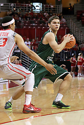 04 December 2013: Kurt Karis looks to get past Zach Lofton during an NCAA  mens basketball game between the Cougars of Chicago State and the Illinois State Redbirds  in Redbird Arena, Normal IL
