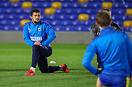 AFC Wimbledon midfielder Cheye Alexander (7) warming up prior to kick off during the EFL Sky Bet League 1 match between AFC Wimbledon and Gillingham at Plough Lane, London, United Kingdom on 23 February 2021.