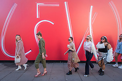 © Licensed to London News Pictures. 15/02/2019. LONDON, UK. Followers of fashion arrive outside the British Fashion Council space at 180 The Strand on the opening day of London Fashion Week.  Designers from around the world will be showing their Autumn and Winter (AW19) creations at a variety of venues in the capital.  Photo credit: Stephen Chung/LNP