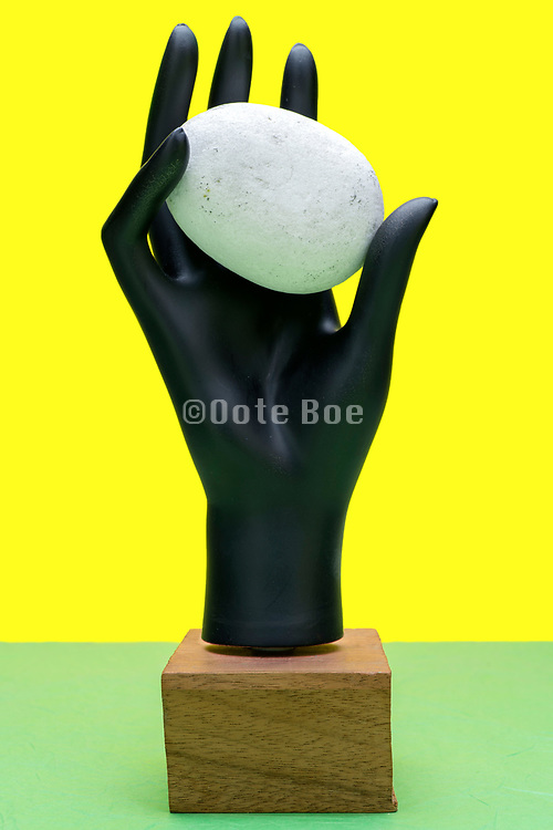 mannequin hand with stone