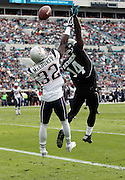 New England Patriots free safety Devin McCourty (32) breaks up a third down pass attempt to leaping Jacksonville Jaguars wide receiver Justin Blackmon (14) in the end zone during the third quarter of the NFL week 16 football game against the Jacksonville Jaguars on Sunday, Dec. 23, 2012 in Jacksonville, Fla. The Patriots won the game 23-16. ©Paul Anthony Spinelli