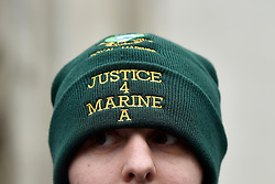 © Licensed to London News Pictures. 08/02/2017. London, UK. A supporter of Sergeant Alexander Blackman stands outside the Royal Courts of Justice in London, where Sgt Blackman has begun an appeal against his life sentence for the murder of a wounded Taliban fighter in Afghanistan in 2011Photo credit: Hannah McKay/LNP