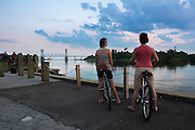 Bikers to a short break to enjoy a sunset along the Cape Fear River in Wilmington, NC. PHOTO BY: JEFF JANOWSKI PHOTOGRAPHY