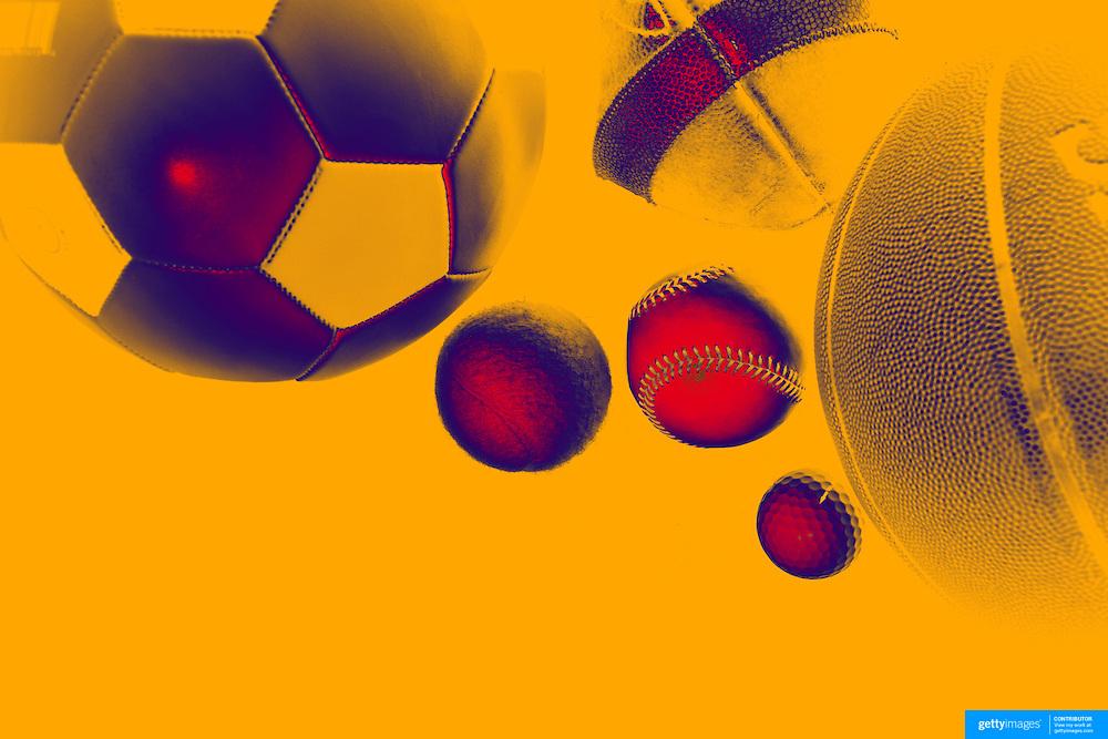 A studio shot of a Baseball, a Basketball an American Football, a soccer ball, a golf ball a tennis ball. 20th October 2012. Photo Tim Clayton