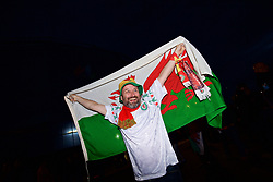 CARDIFF, WALES - Monday, October 9, 2017: A Wales supporter with a flag outside the stadium before the 2018 FIFA World Cup Qualifying Group D match between Wales and Republic of Ireland at the Cardiff City Stadium. (Pic by Paul Greenwood/Propaganda)