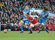 Arsenal's Alexis Sanchez goes down under the challenge of Bournemouth's Nathan Ake but no penalty is given during the Premier League match at the Emirates Stadium, London. Picture date October 26th, 2016 Pic David Klein/Sportimage