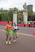 Slovenian para-athlete, Sandi Novak with his running guide, on The Mall during The Virgin London Marathon on 28th April 2019 in London in the United Kingdom. Now in it's 39th year, the London Marathon is a large sporting event with over 40,000 runners expected to take part.