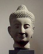 Head of Buddha. 14th century post-Bayon style (1250-1431). Sandstone Sculpture From The Bayon Temple, Cambodia