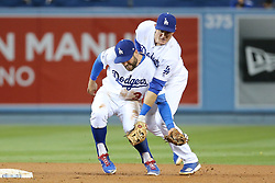 May 11, 2018 - Los Angeles, CA, U.S. - LOS ANGELES, CA - MAY 11: LOS ANGELES, CA - MAY 11: Los Angeles Dodgers Infield Chase Utley (26) and Los Angeles Dodgers Infield Chris Taylor (3) collide as they try to field a grounder and get the force out at second but the delay prevents the double play in the game between the Cincinnati Reds and the Los Angeles Dodgers on May 11, 2018 at Dodger Stadium in Los Angeles, CA.. (Photo by Peter Joneleit/Icon Sportswire)in the game between the Cincinnati Reds and the Los Angeles Dodgers on May 11, 2018 at Dodger Stadium in Los Angeles, CA.. (Photo by Peter Joneleit/Icon Sportswire) (Credit Image: © Peter Joneleit/Icon SMI via ZUMA Press)