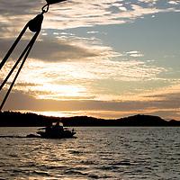 Australia, Queensland, Great Barrier Reef. Sailing, boats, sunset