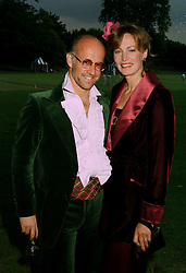 MR & MRS ROGER SAUL head of Mulberry the leading British fashion house, at a ball in London on 17th June 1997.LZL 25