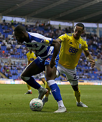Reading's Yakou Meite and Birmingham City's Josh Dacres-Cogley battle for the ball