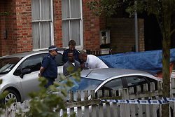 © licensed to London News Pictures. LONDON, UK  12/05/2011. A 15 year old boy has died after being found with stab wounds near to the corner of Cormont Road and Calais Street in Camberwell. A man is searched and put nin a car outside a house. It is unclear how the house or man are connected with the investigation. Please see special instructions for usage rates. Photo credit should read CLIFF HIDE/LNP
