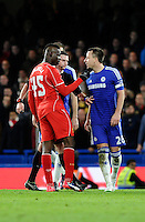 Chelsea's John Terry clashes with Liverpool's Mario Balotelli<br /> <br /> Photographer Ashley Western /CameraSport<br /> <br /> Football - Capital One Cup Semi Final Second Leg - Chelsea v Liverpool - Tuesday 27th January 2015 - Stamford Bridge - London<br /> <br /> © CameraSport - 43 Linden Ave. Countesthorpe. Leicester. England. LE8 5PG - Tel: +44 (0) 116 277 4147 - admin@camerasport.com - www.camerasport.com