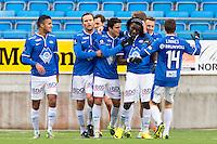 Treningskamp fotball 2014: Molde - Aalesund. Moldes Mohamed Elyounoussi (nr 3 f.v.) gratuleres av lagkameratene etter 1-0 i treningskampen mellom Molde og Aalesund på Aker stadion.