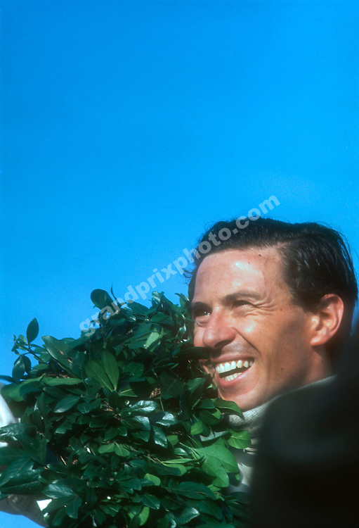 Jim Clark on the podium after his win in the 1967 Mexican Grand Prix in Mexico City Photo: Grand Prix Photo
