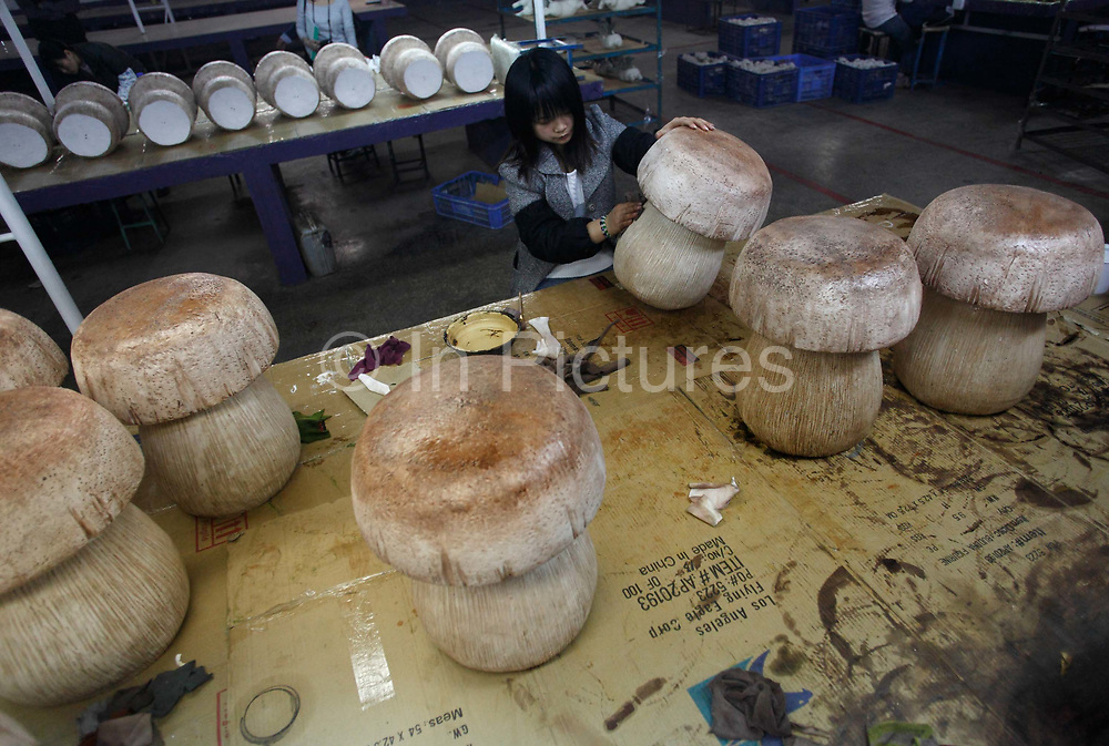 Workers make petroleum resin based gift items and garden ornaments at the Chuan Sen Art & Design Factory on the outskirts of Guangzhou, in Guangdong Province, China on 04 February, 2009.  Orders at the factory, who sells almost all of their wares in North America and Europe, has declined drastically in the last two years.Workers make petroleum resin based gift items and garden ornaments at the Chuan Sen Art & Design Factory on the outskirts of Guangzhou, in Guangdong Province, China on 04 February, 2009.  Orders at the factory, who exports almost all of their wares in North America and Europe, has declined drastically in the last two years due to the economic slowdown and western consumers' belt-tightening.