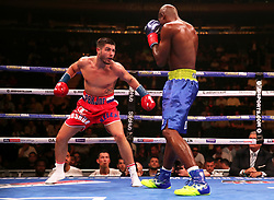 Josh Kelly (left) in action against Ray Robinson in the WBA International Welterweight title fight at Madison Square Garden, New York.
