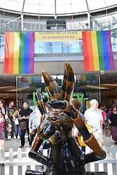 Norwich Pride, 28 July 2018 UK - rainbow flags inside The Forum in front of one of the GoGo Hares