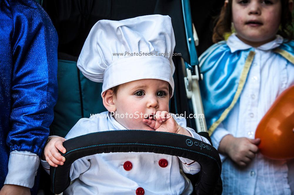 Baby in Purim costume Photographed in Bnei Brak, Israel