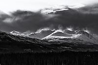 High winds blow the snow from the tops of the Cassiar Mountains