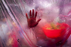 August 3, 2017 - Dhaka, Bangladesh - People use a plastic sheet to protect themselves from a heavy rainfall in Dhaka city. In the last few days, the weather has caused major flooding in Dhaka. (Credit Image: © K M Asad via ZUMA Wire)